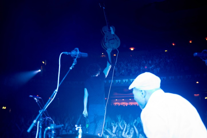 Jack White holding his beloved 1950′s Kay Hollowbody Archtop guitar during a break in set closer 'Seven Nation Army'